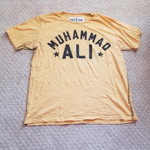 acb571cd Roots of Fight Muhammad Ali tee. M_5b38ed53aa57199c7c763458